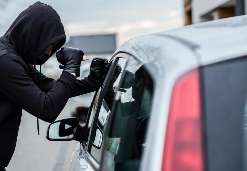 bigstock-Car-Thief-Trying-To-Break-Into