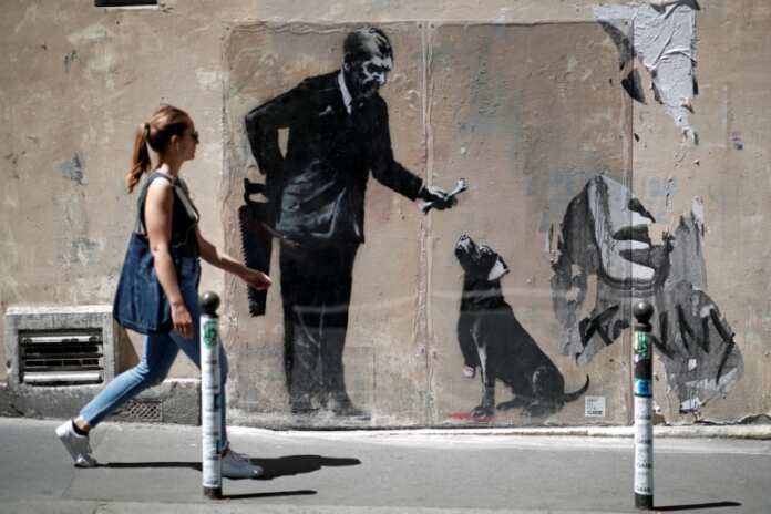 Banksy man with dog