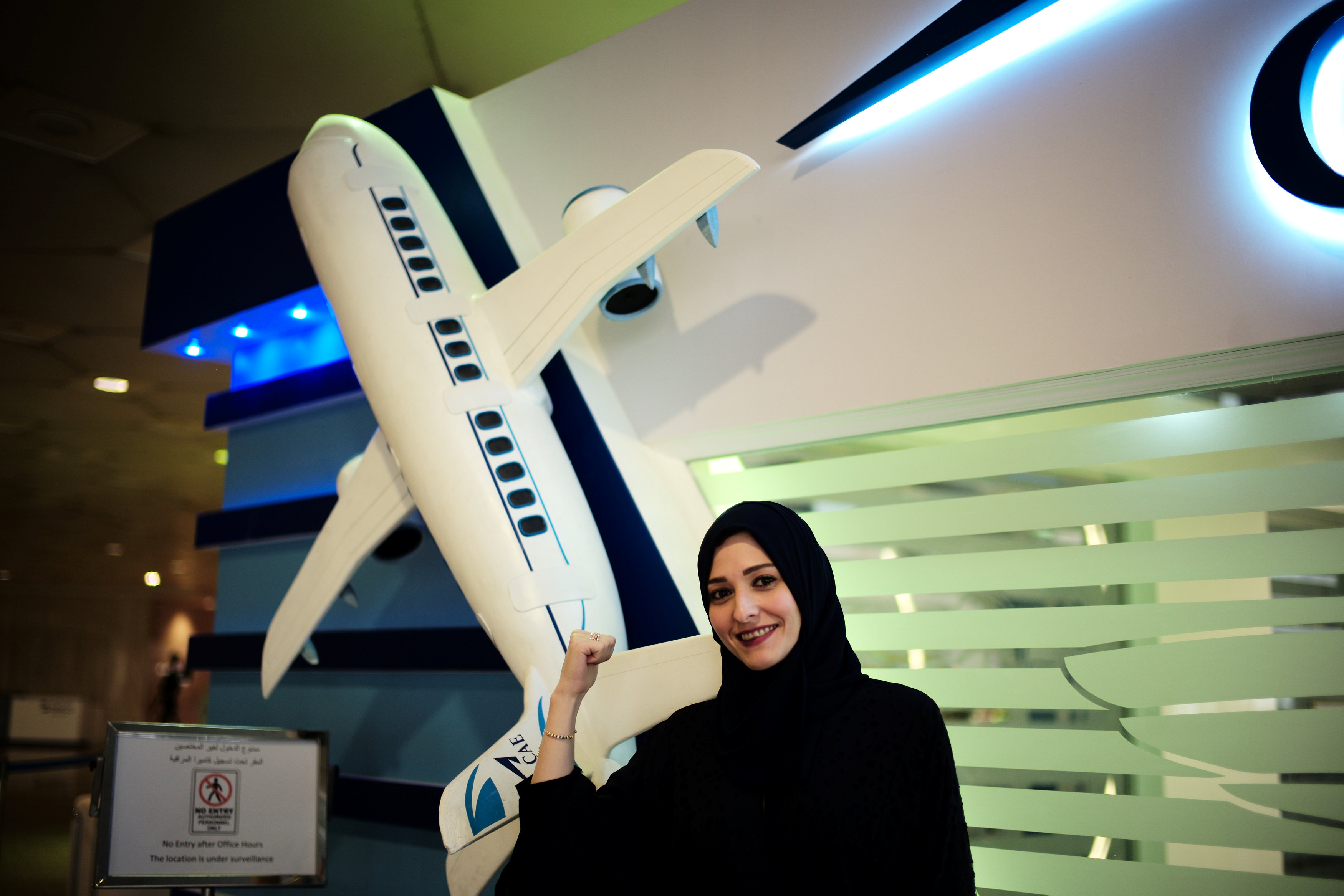 Dalia Yashar, one of the first Saudi students who registered to become a commercial pilot, stands at King Fahd International Airport in Damman