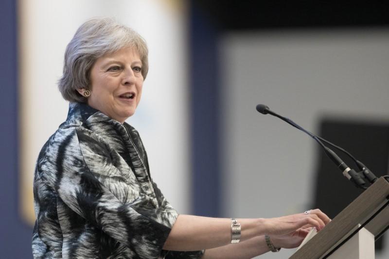 FILE PHOTO - Britain's Prime Minister, Theresa May speaks at the Farnborough Airshow, in Farnborough