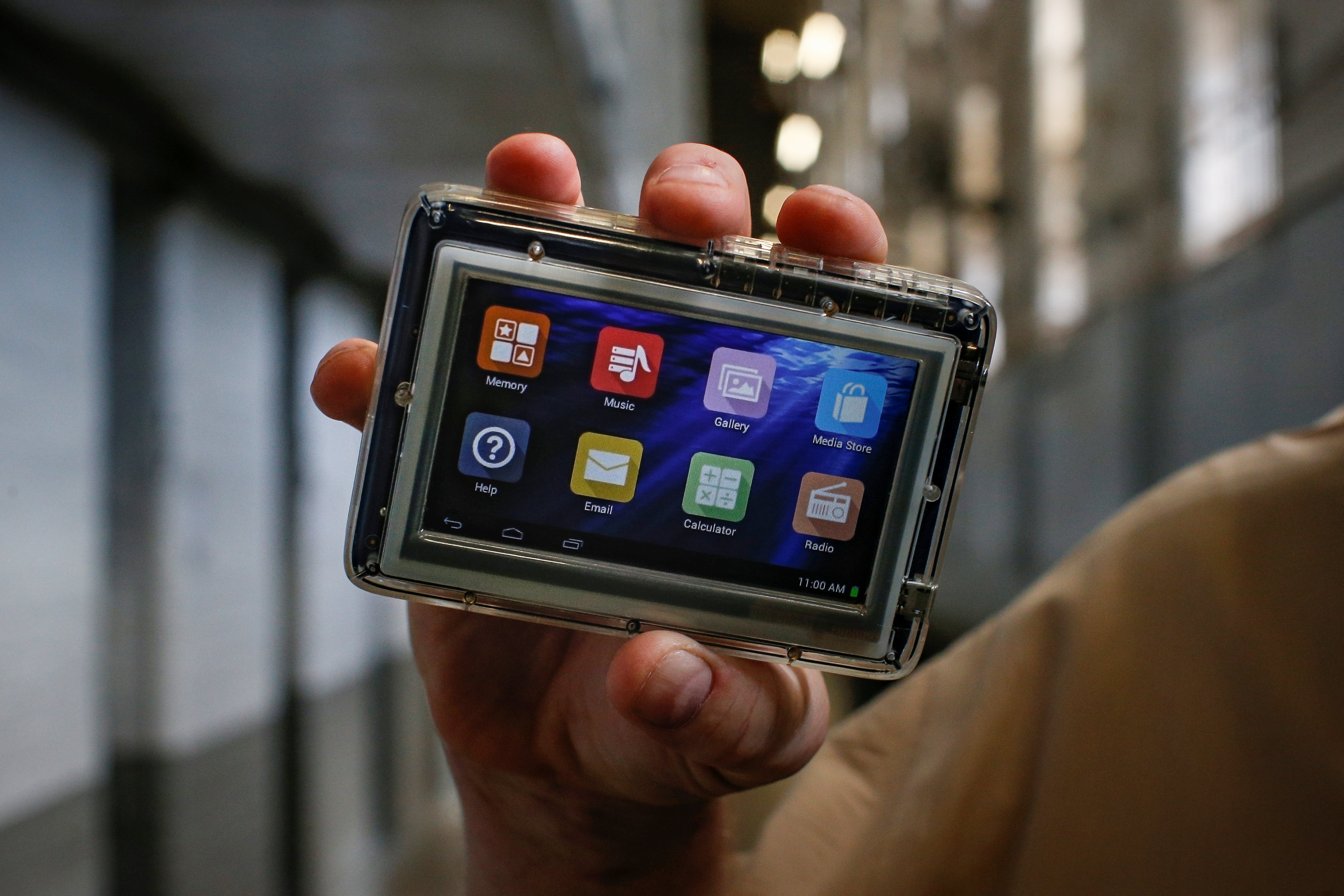 Inmate Steven Goff shows his JPay tablet device inside the East Jersey State Prison in Rahway, New Jersey