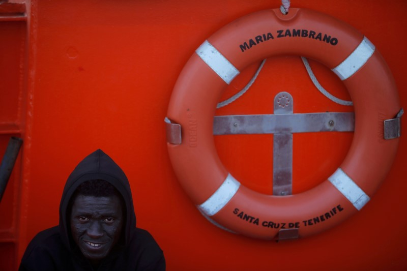 A migrant waits on a rescue boat to disembark after arriving at the port of Algeciras