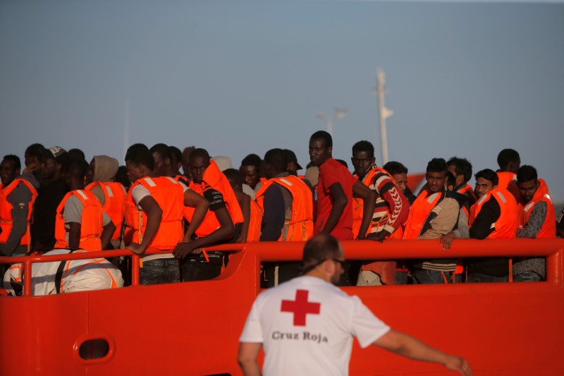 Migrants are seen on a rescue boat after arriving at the port of Malaga