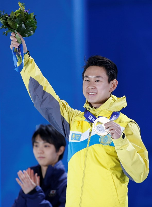 FILE PHOTO: Ten celebrates during the victory ceremomy after the figure skating men's free skating program at the Sochi 2014 Winter Olympics in Sochi