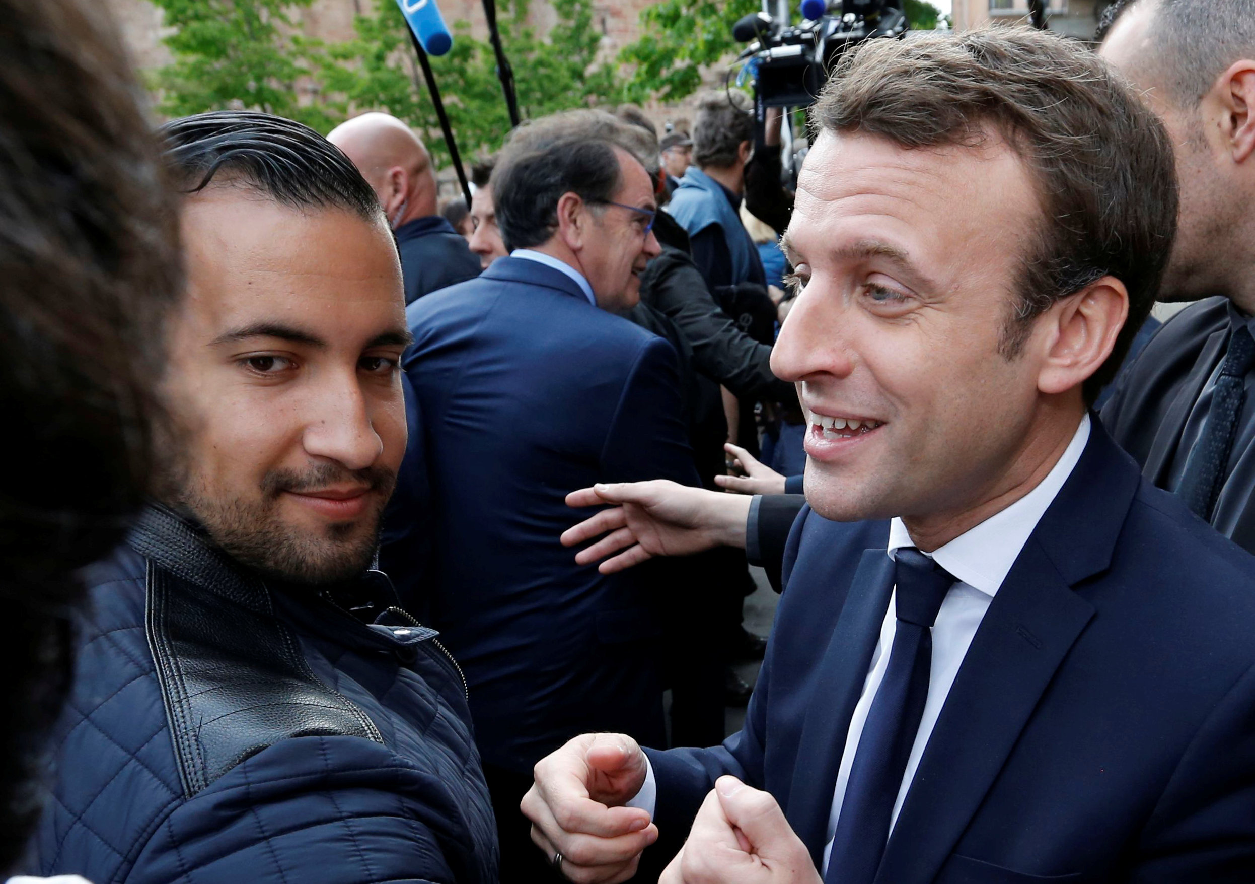 Emmanuel Macron, head of the political movement En Marche !, or Onwards !, and candidate for the 2017 presidential election, flanked by Alexandre Benalla, head of security, attends a campaign visit in Rodez