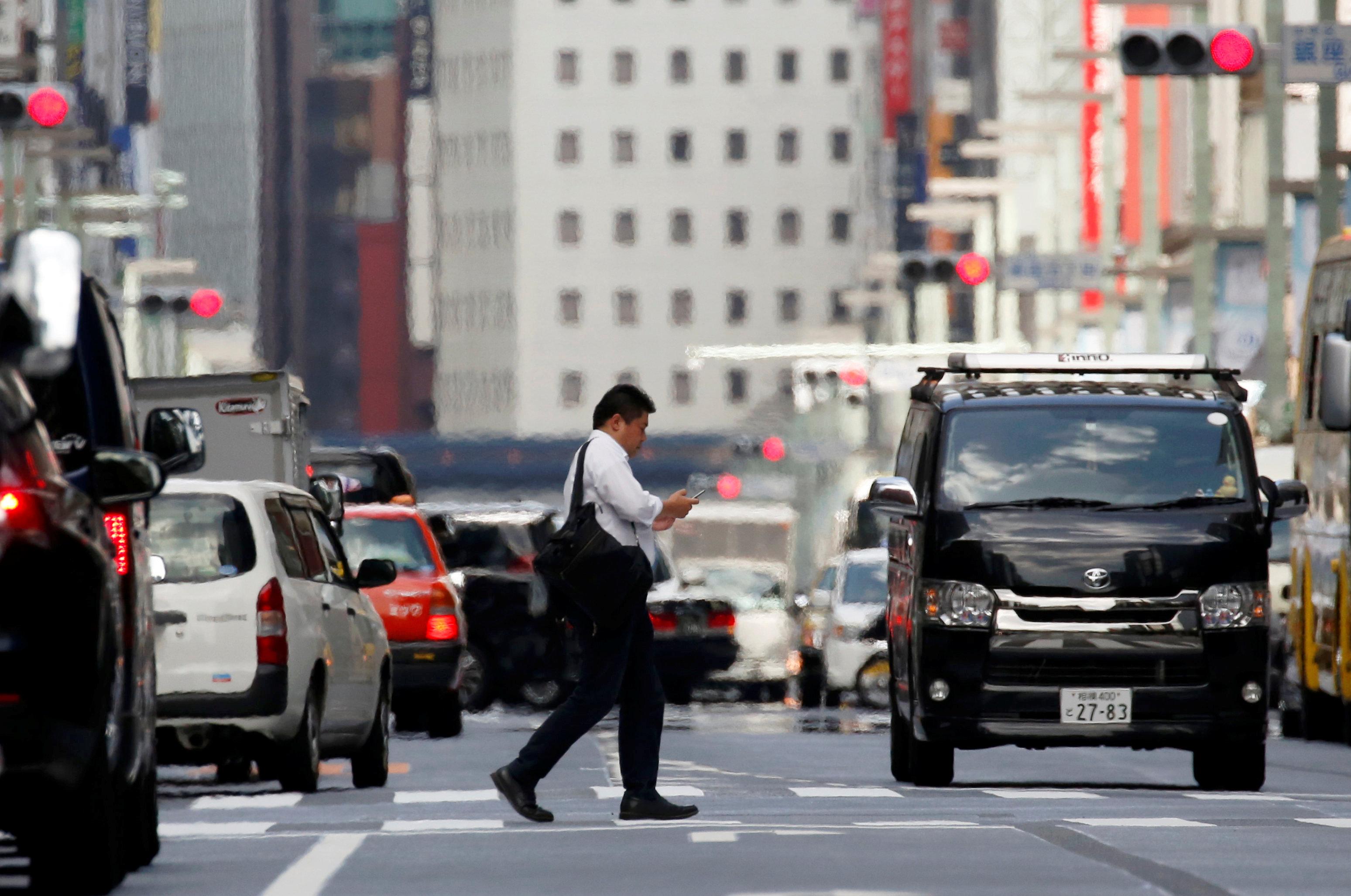 Japan heatwave - man on crosswalk