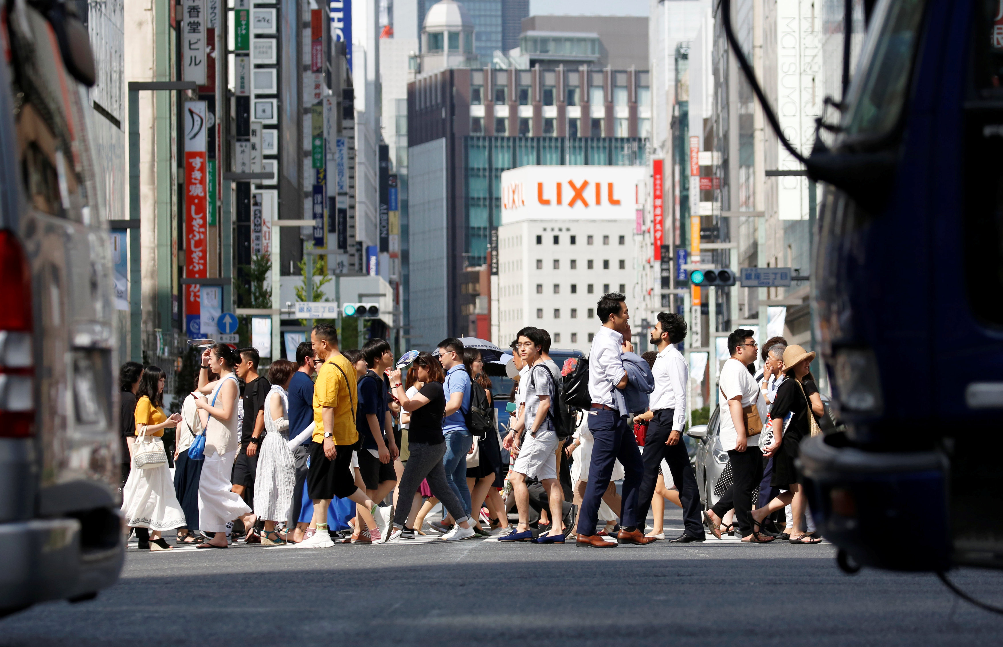 Japan crowded intersection in summer heatwave