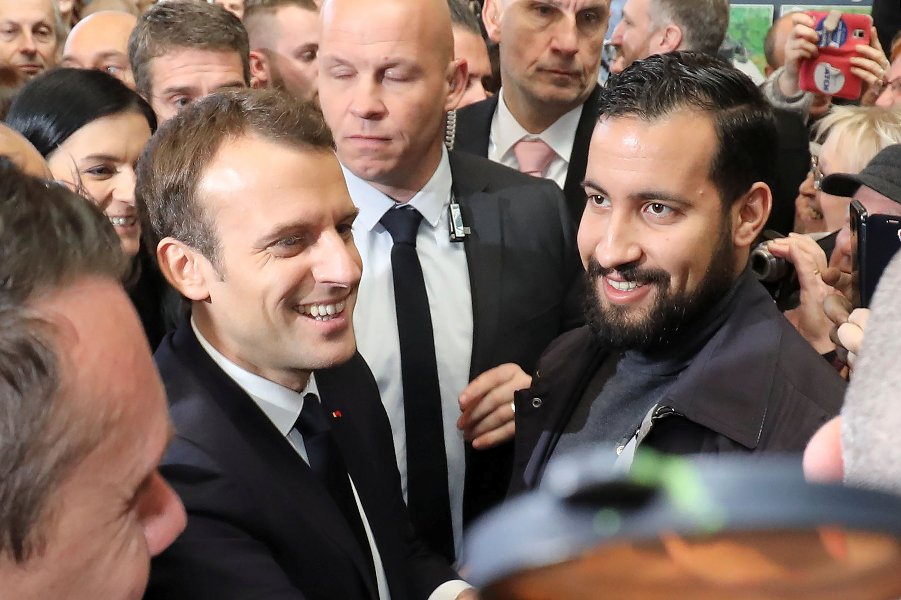 French President Emmanuel Macron, flanked by Elysee senior security officer Alexandre Benalla, visits the 55th International Agriculture Fair at the Porte de Versailles exhibition center in Paris