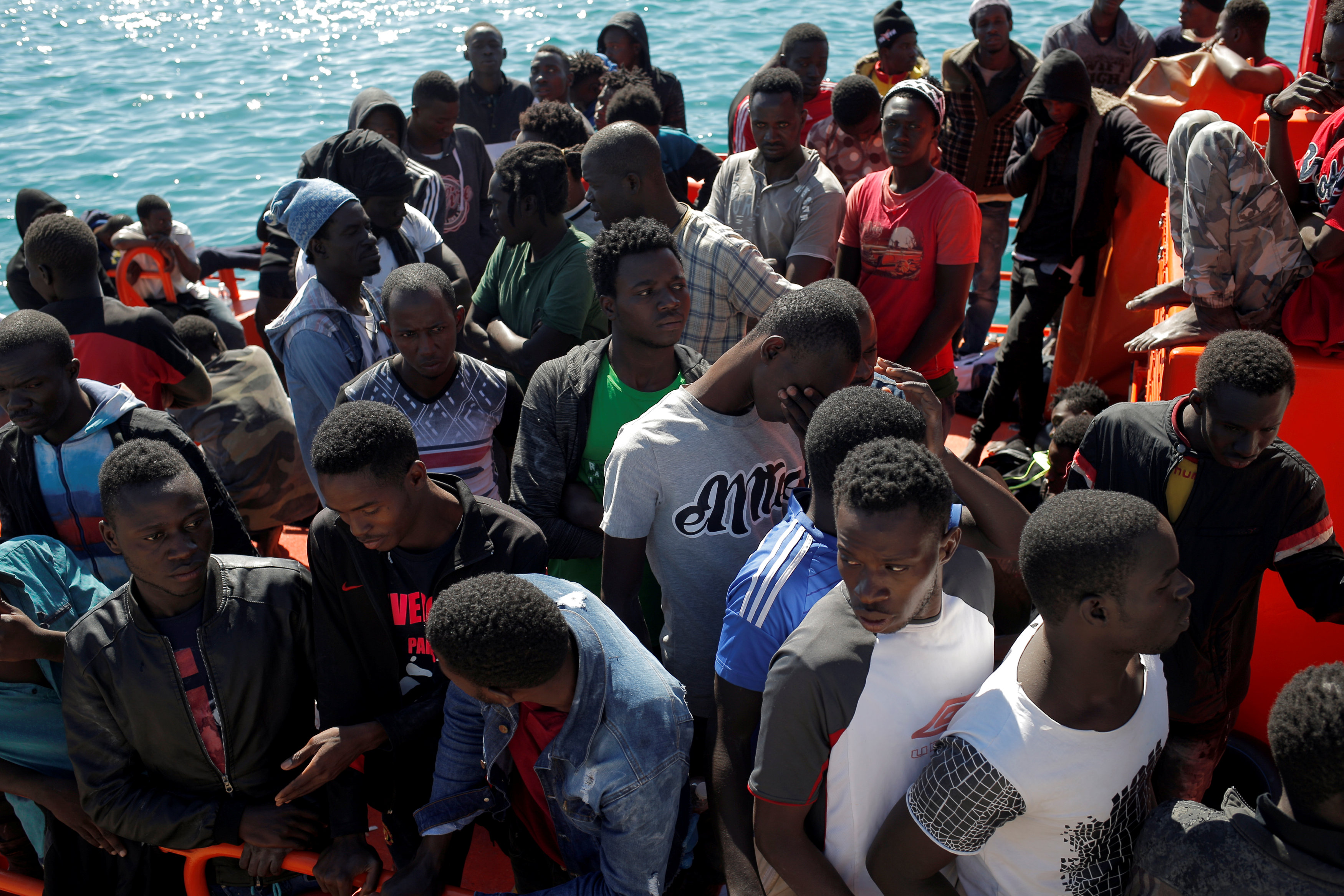 Migrants are seen on a rescue boat as they wait to disembark after arriving at the port of Tarifa