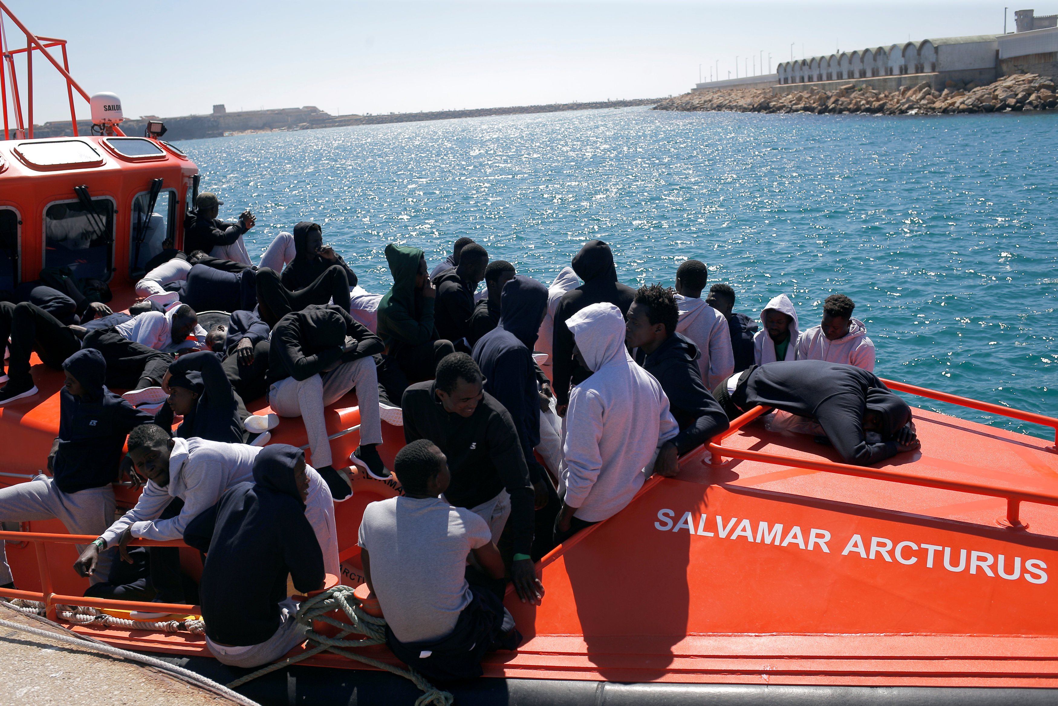 Migrants are seen on rescue boat as they wait to disembark at port of Tarifa