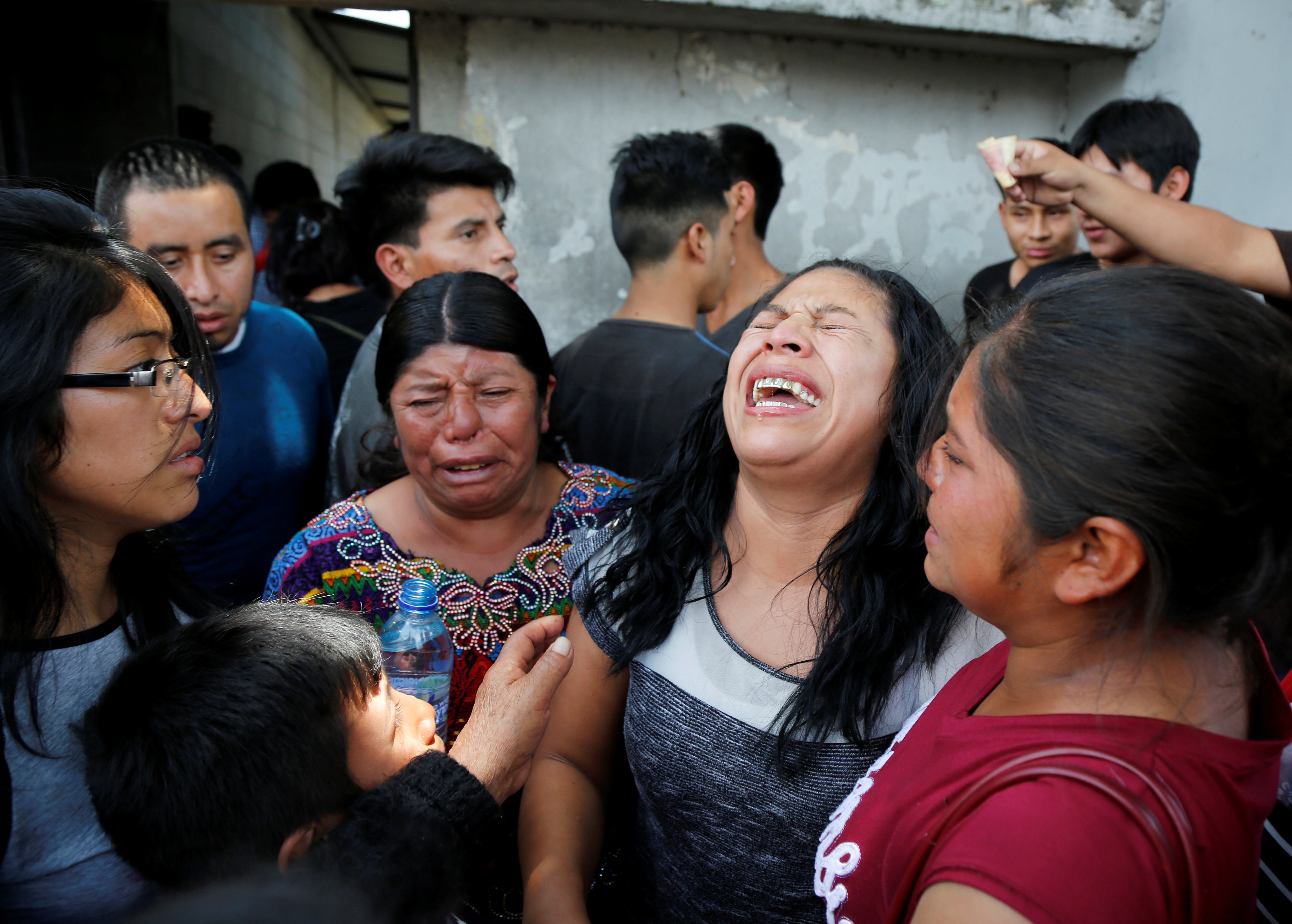 Guatemalan migrant Maria del Carmen Tambriz reacts after being returned from the U.S. without her daughter after they were separated by U.S. border officials in Guatemala city