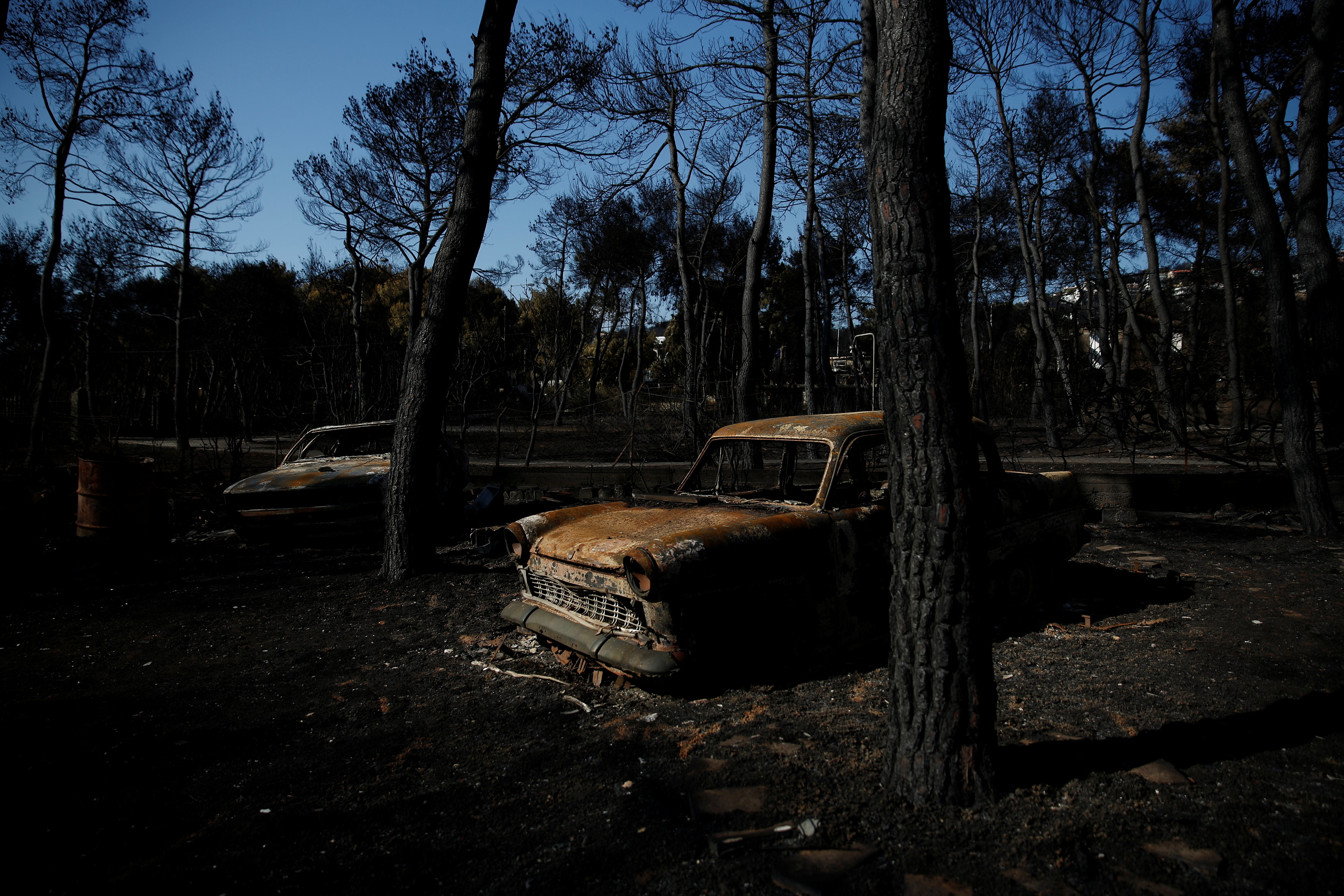 Burnt cars are seen following a wildfire in the village of Mati, near Athens