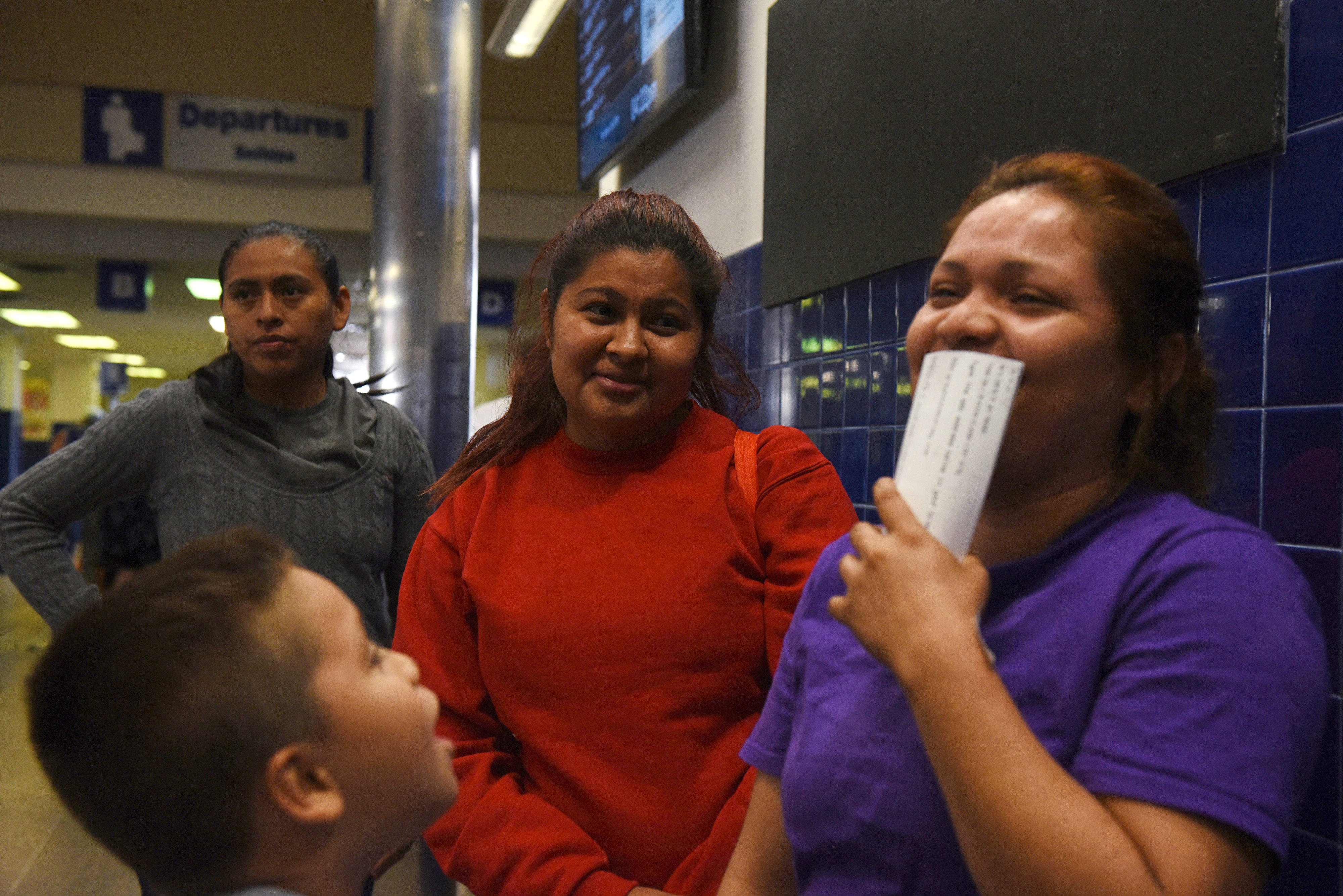After being released from detention centers, undocumented immigrants wait for buses, which will take them to various cities across the country, at a Greyhound bus station in San Antonio