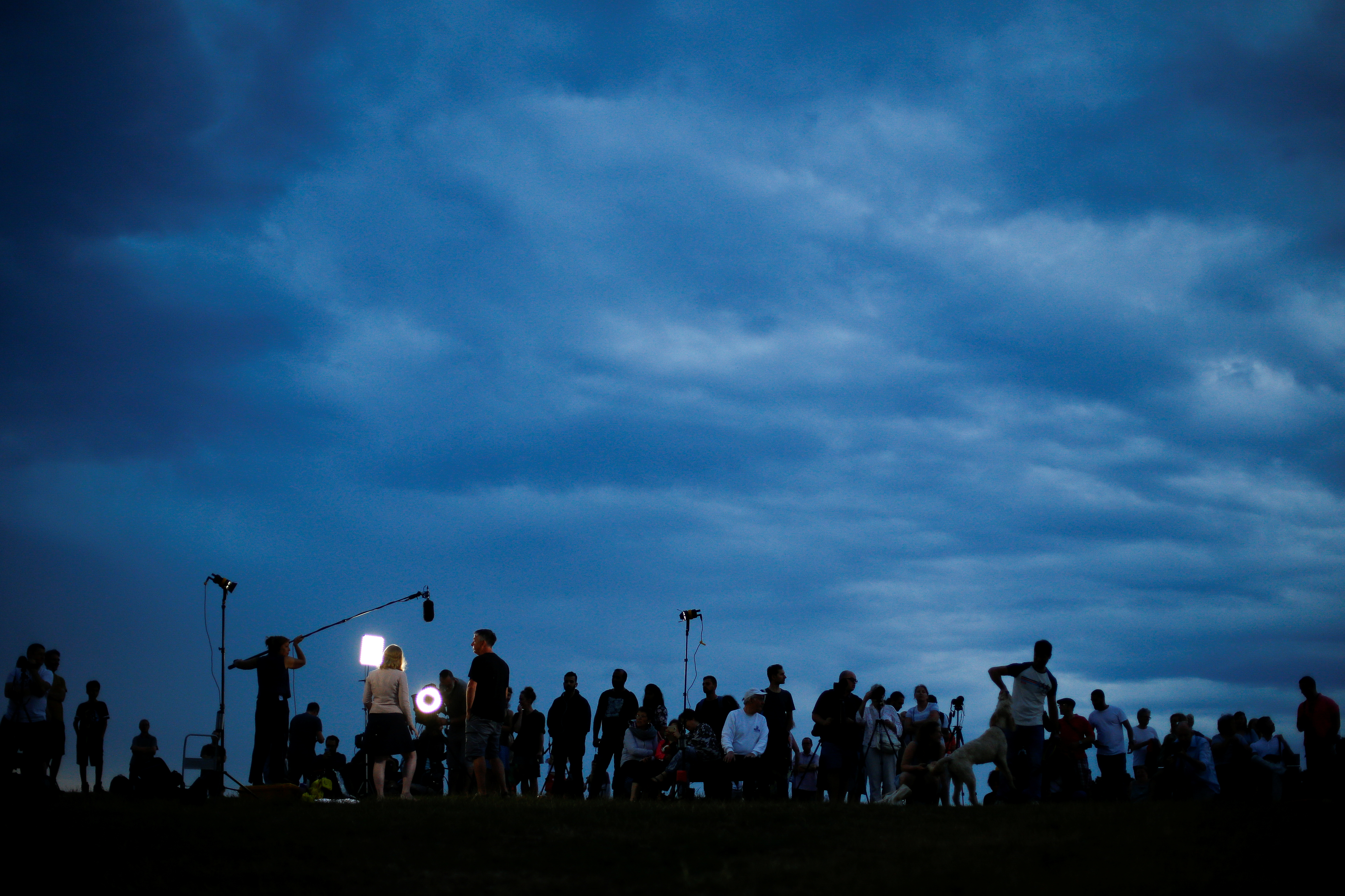 People gather on Hampstead Heath to observer the lunar eclipse, in London