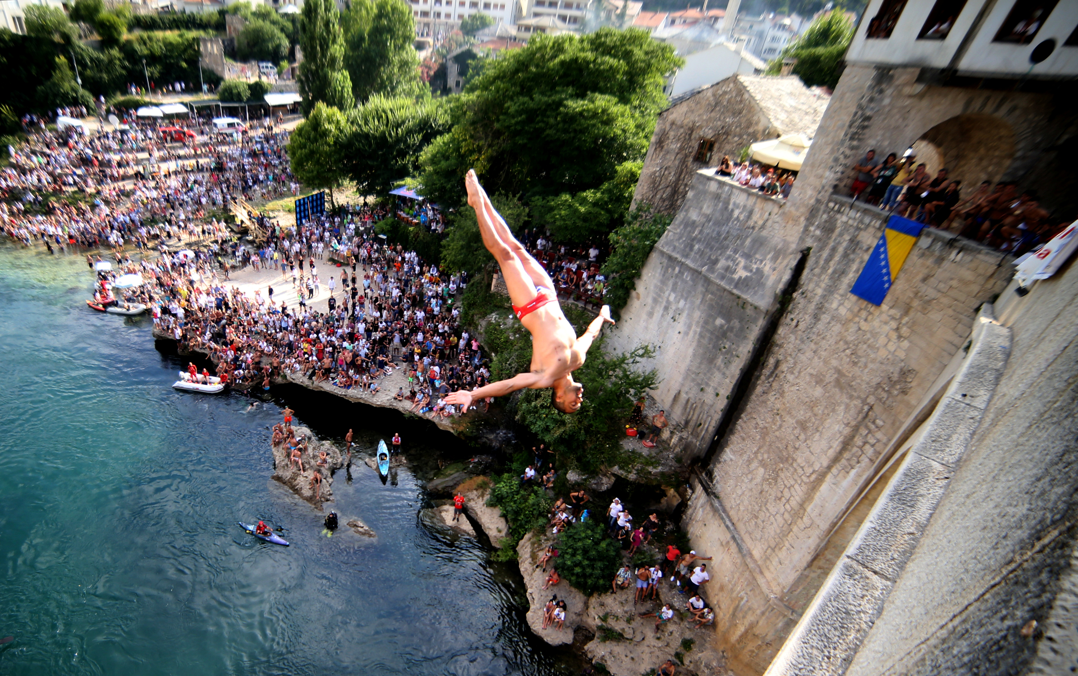 A man jumps from the Old Bridge during the 452nd traditional diving competition in Mostar