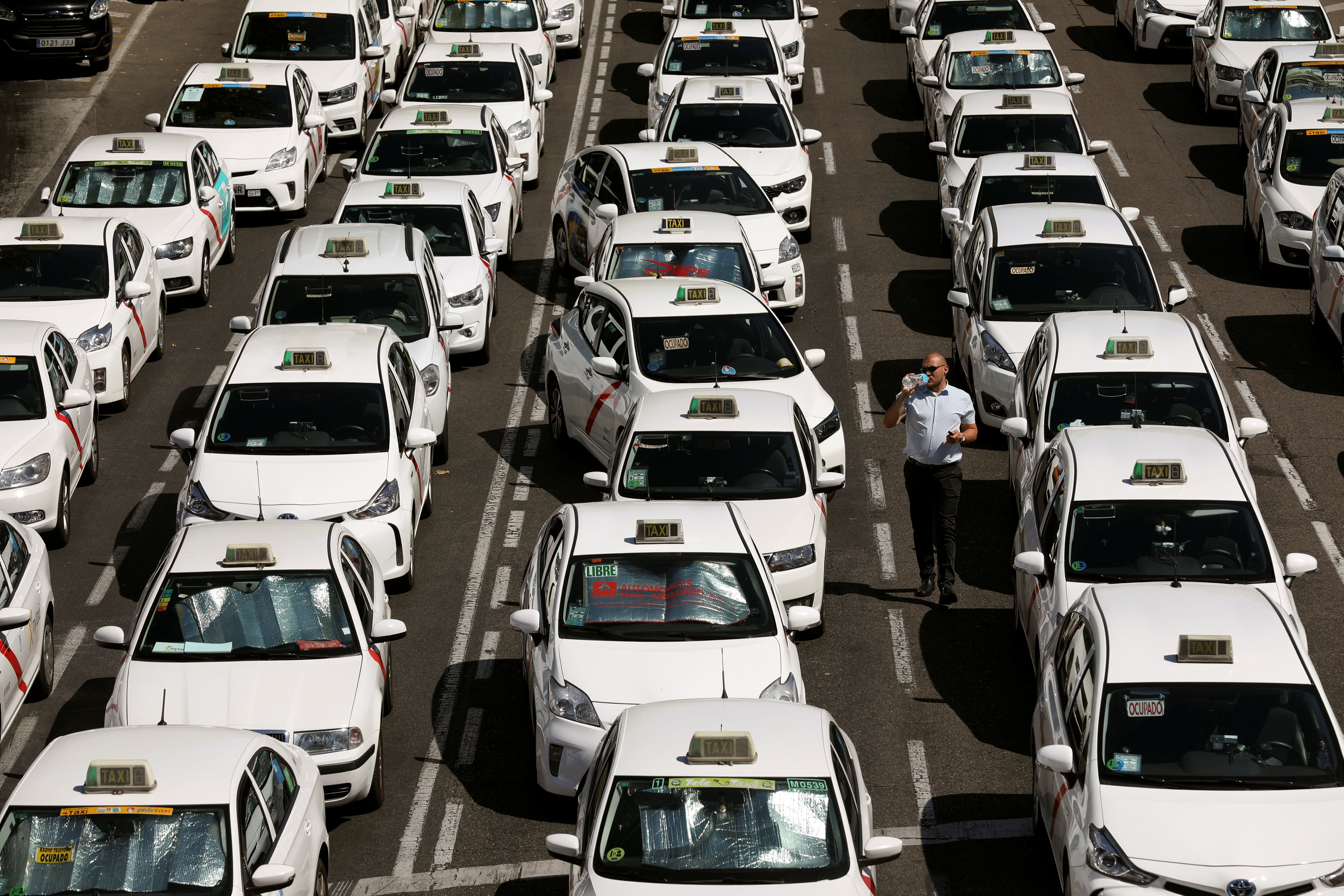 Parked taxis block a section of Paseo de la Castellana, one of Madrid's main avenues, during a strike, in Madrid