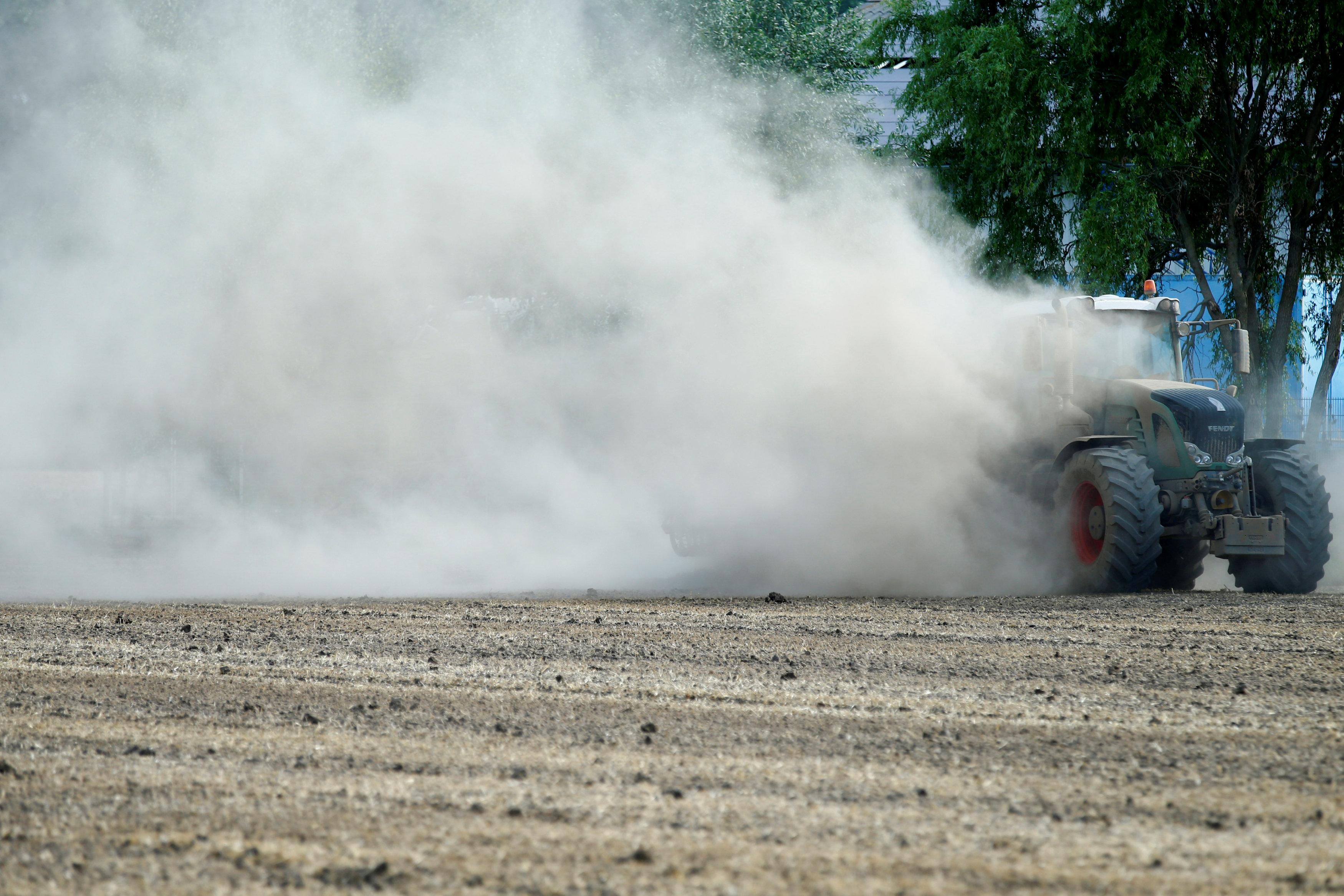 A farmer harrows a dried out field near Geinsheim