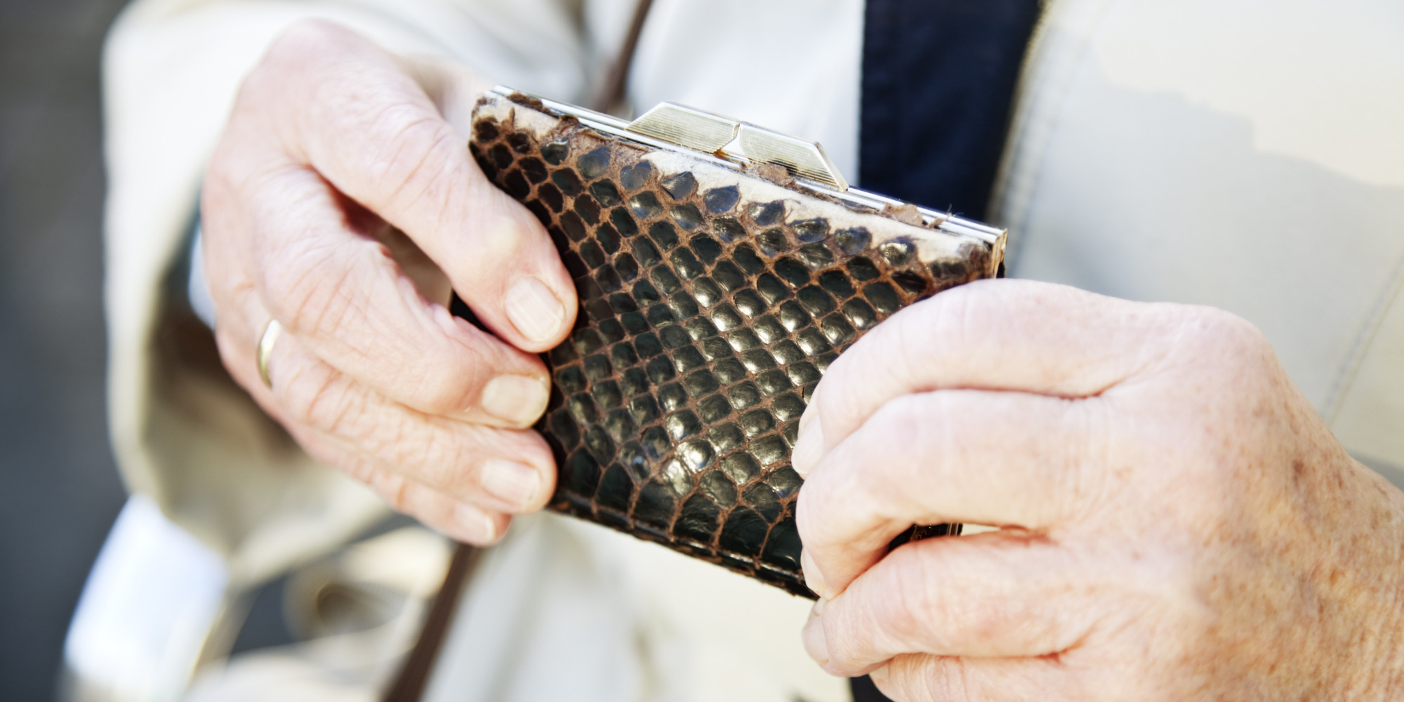 Senior hands holding purse