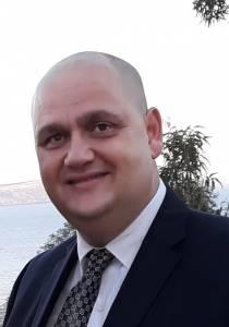 Dr Kevin Mompalao