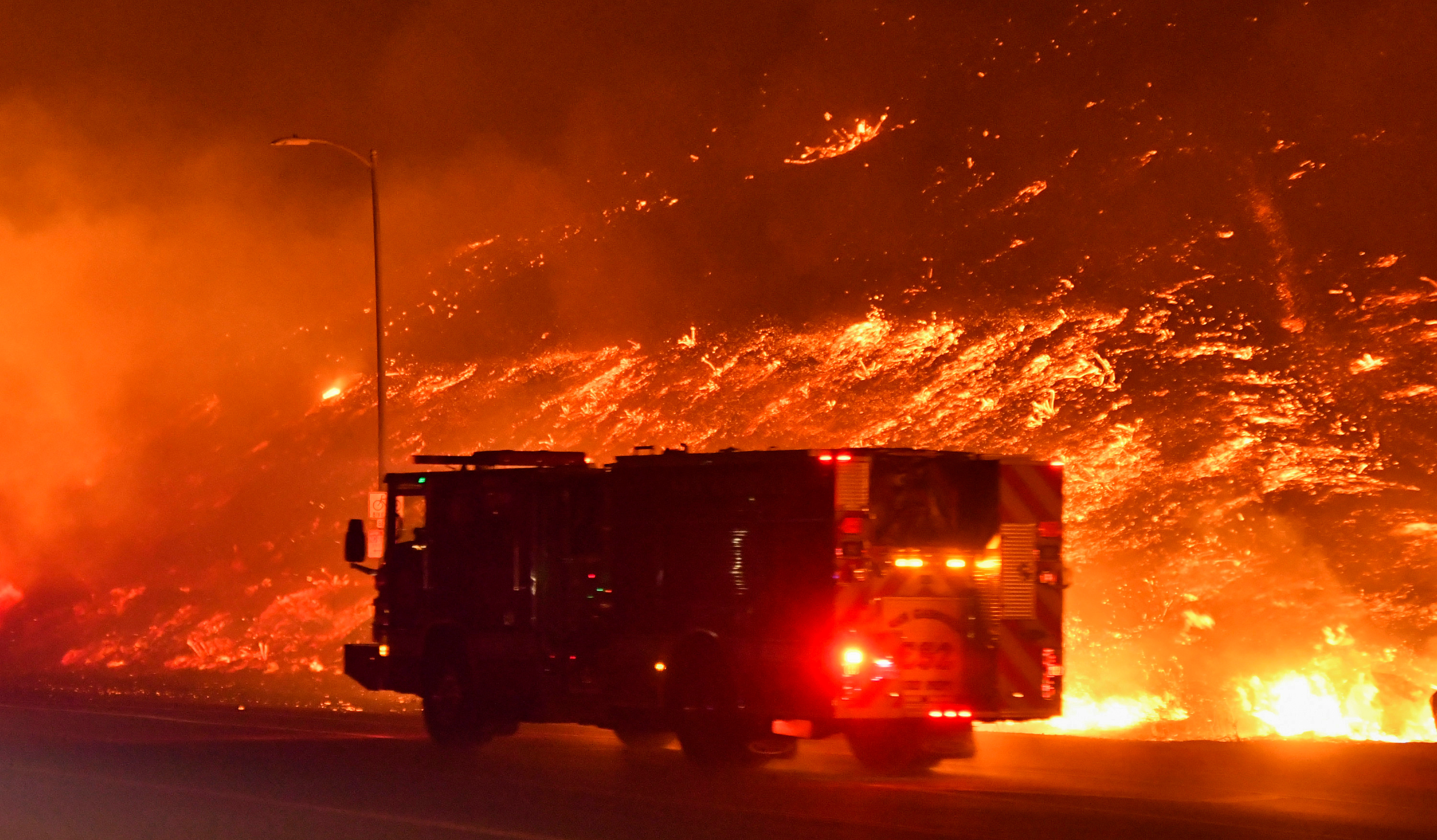 one man dies as wind-driven los angeles wildfire forces