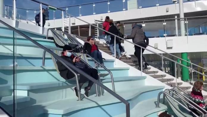 Passengers are seen onboard the Costa Smeralda cruise ship in Civitavecchia