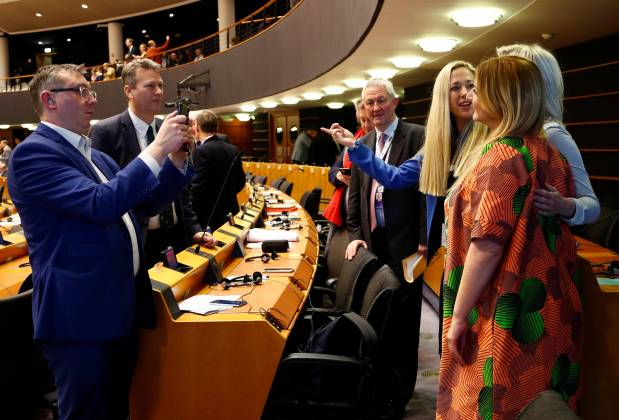 British members of the chamber pose for a photograph during their last plenary session at the European Parliament in Brussels