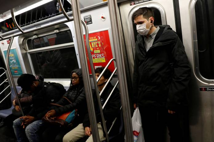 A man in a face mask rides the subway in Manhattan, New York City, after further cases of coronavirus were confirmed in New York