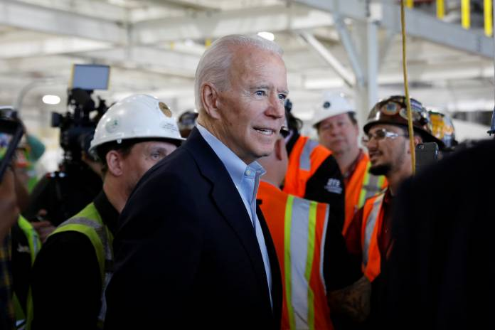 Democratic U.S. presidential candidate Biden greets workers during campaign stop at FCA Mack Assembly plant in Detroit, Michigan