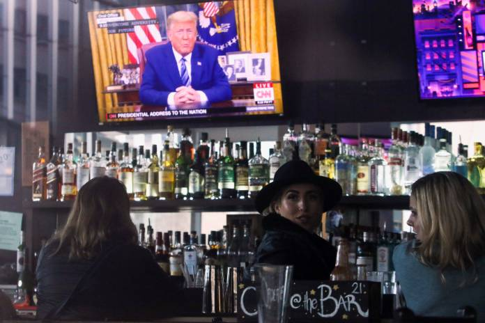 U.S. President Donald Trump's televised address to the nation is pictured in the bar at A Pizza Mart, in Seattle, Washington