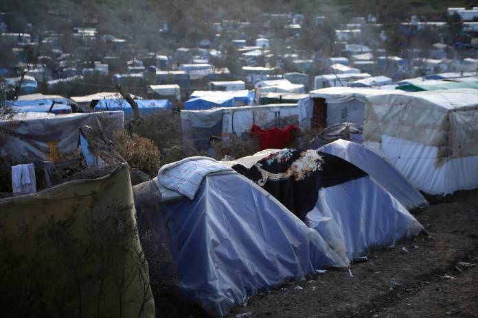 FILE PHOTO: A view of a makeshift camp for refugees and migrants next to the Moria camp, on the island of Lesbos
