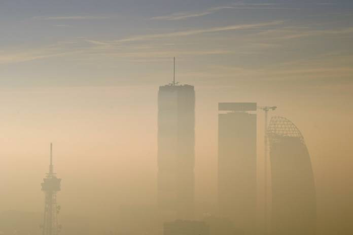 FILE PHOTO: The Allianz Tower, the Libeskind Tower and the Generali Tower are pictured amidst dense fog and smog in Milan, Italy, January 8, 2020. REUTERS/Flavio Lo Scalzo
