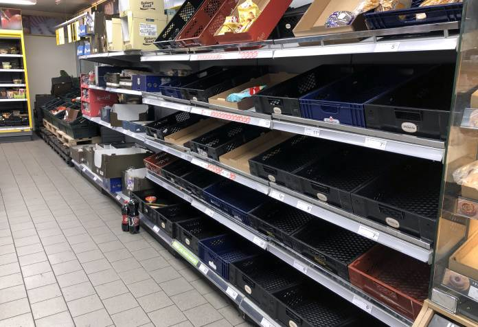 View of empty shelves at a supermarket as people began stockpiling food in Copenhagen