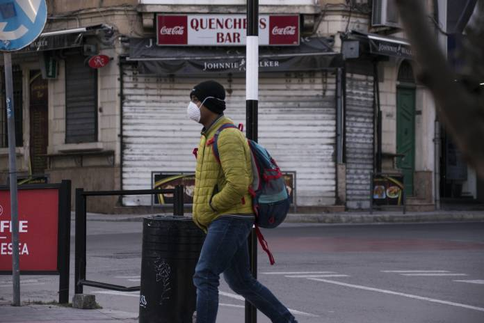 a man wears a mask outside St Julians coronavirus