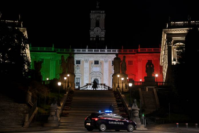 Rome's Town Hall is lit up with the colours of the Italian flag to show solidarity with the country as it continues to battle coronavirus, in Rome