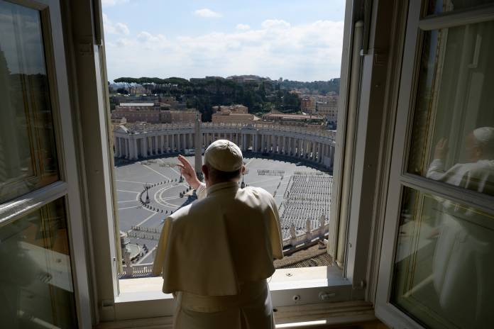 Pope Francis sends a virtual hug after delivering his weekly Angelus prayer via video at the Vatican