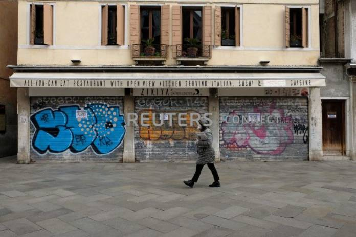 A person walks in a nearly empty Venice after Italy tightened the lockdown measures to combat the coronavirus disease (COVID-19) outbreak in Venice
