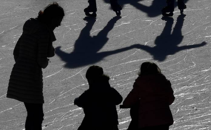 shadows on people in the street
