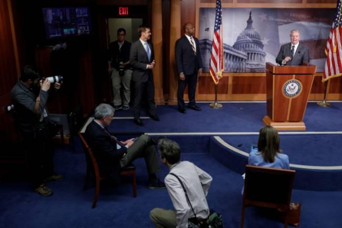 Republican Senators discuss the coronavirus relief bill ahead of a vote on Capitol Hill in Washington