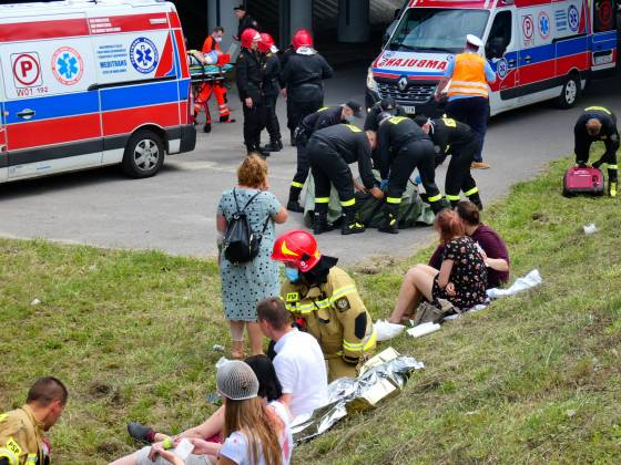 First responders attend to the scene of a public bus crash in Warsaw