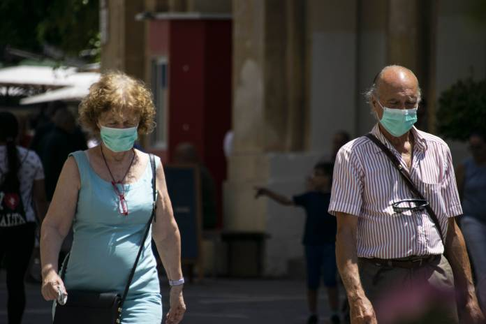 Elderly-couple-wearing-masks-Valletta-coronavirus
