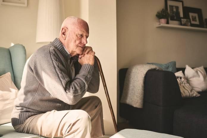Elderly-man-sitting-alone