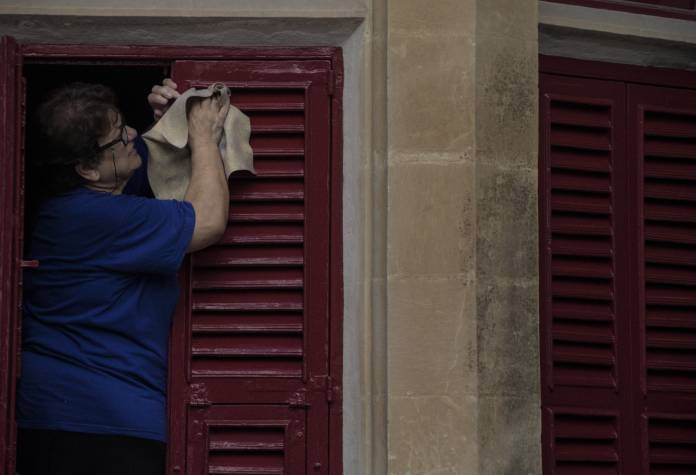 woman-cleans-maltese-traditional-window