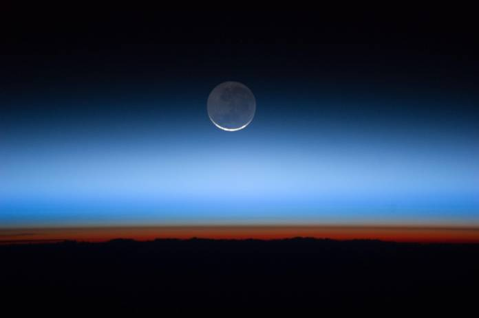Hovering_on_the_Horizon_-_NASA_Earth_Observatory