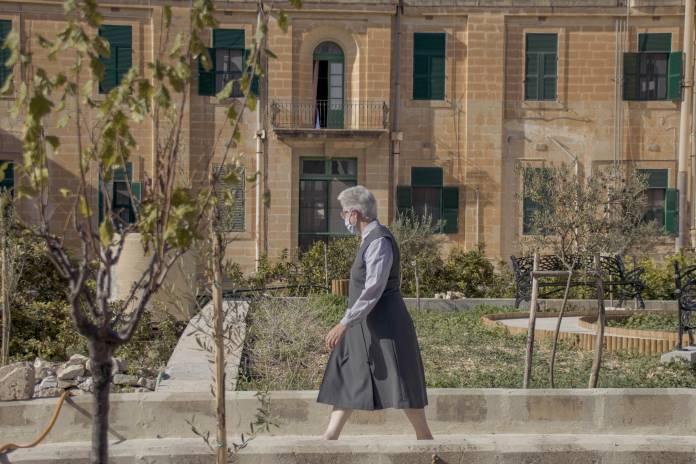 a-nun-walks-in-tal-kleru-garden