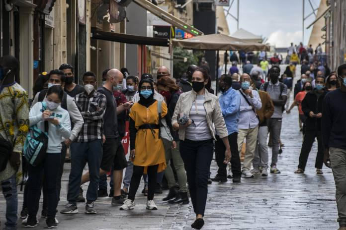 People-queue-at-BOV-wearing-masks-valletta