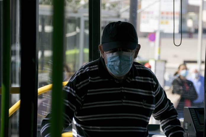 man-wearing-mask-on-tallinja-bus-coronavirus