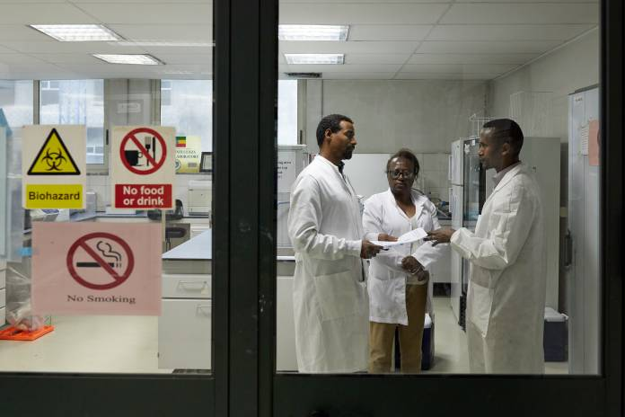 "Lab workers at Ethiopia's National Influenza and Arbovirus Laboratory on 11 February 2020. The lab started testing for COVID-19 on 7 February 2020..""The test is not complicated. We now have the reagents and the necessary documentation. Once the samples are submitted we provide results within the same day. Currently we receive up to four samples a day for testing, but we anticipate that this will increase,"" says Adamu Tayachew, who heads an eight-member technician team at the National Influenza and Arbovirus Laboratory. ..Ethiopia is strengthening surveillance, diagnostics and medical care and public health information in readiness for a potential coronavirus outbreak. The country is a major African airline gateway. Its national airline operates 34 flights a week to China. ..For more see: https://www.afro.who.int/news/ethiopia-stepping-readiness-coronavirus-disease-outbreak.Photo: WHO/Otto Bakano. ."