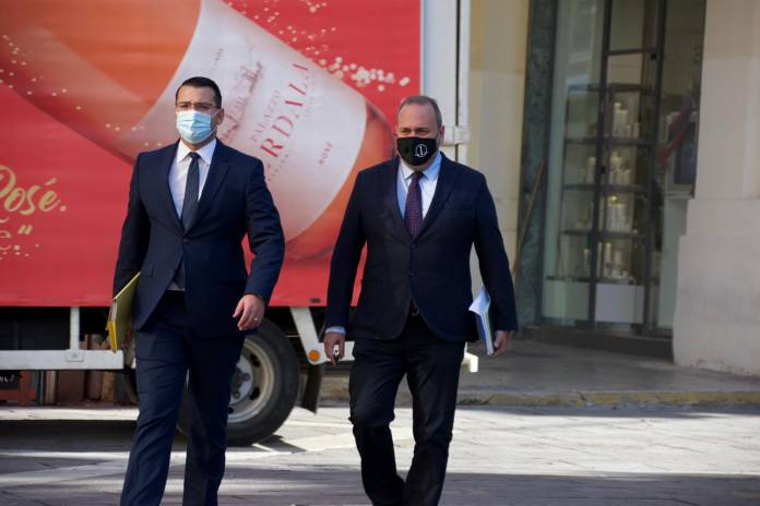 Chris Cardona walking to court to appear before public inquiry