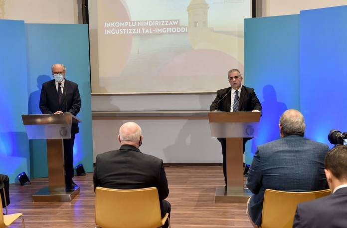 Minister for Finance and Financial Services Edward Scicluna and Minister for the Family, Children's Rights and Social Solidarity Michael Falzon address a press conference about payments for past injustices Malta Stock Exchange, Valletta