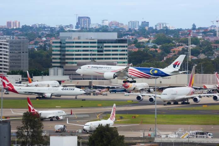 Malaysia Airlines landing at Sydney Airport.